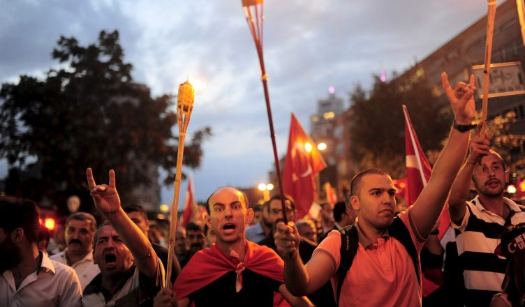 Supporters of ultra-nationalist groups shout slogans during a protest against recent Kurdish militant attacks on Turkish security forces, in Istanbul, Turkey, September 8, 2015. Kurdish militants killed 15 police officers in two bomb attacks in eastern Turkish provinces on Tuesday, a government official said, widening a conflict with the Turkish state. More than 40 Turkish warplanes hit Kurdistan Workers Party (PKK) targets overnight in northern Iraq, where the group has bases, in response to Sunday's killing of 16 soldiers near the Iraqi border, the deadliest attack since a two-year-old ceasefire ended. Tuesday's bombing in Igdir province that killed 14 police officers in a minibus was the latest in a daily stream of attacks by the PKK on soldiers and police in eastern Turkey since fighting resumed in July. A separate bomb attack in southeastern province Mardin killed one police officer and wounded three others. REUTERS/Yagiz Karahan  - RTX1RPA8